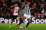 Jake Livermore of West Bromwich battles with Shane Long of Southampton .Premier league match, Southampton v West Bromwich Albion at the St. Mary's Stadium in Southampton, Hampshire, on Saturday 21st  October 2017.<br /> pic by Bradley Collyer, Andrew Orchard sports photography.