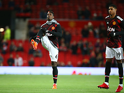 Manchester United's Paul Pogba warms up alongside Manchester United's Marcus Rashford
