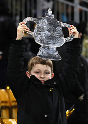 Jack Lock holds up a foil FA Cup banner during the FA Cup quarter final match at Molineux, Wolverhampton.