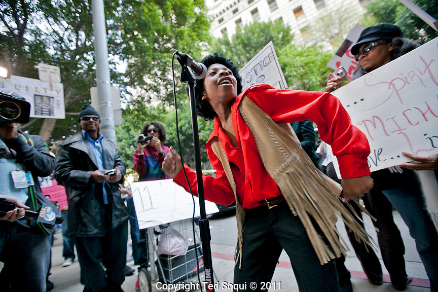 Daniel Moore age 10 from Burbank performs Michael Jackson songs after the verdict..Michael Jackson verdict at the Criminal Courts building in downtown L.A.