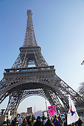 January, 21st, 2017 - Paris, Ile-de-France, France: Protesters march past Eiffel Tower. Thousands of protesters in Paris join anti-Trump Women's March around the world.