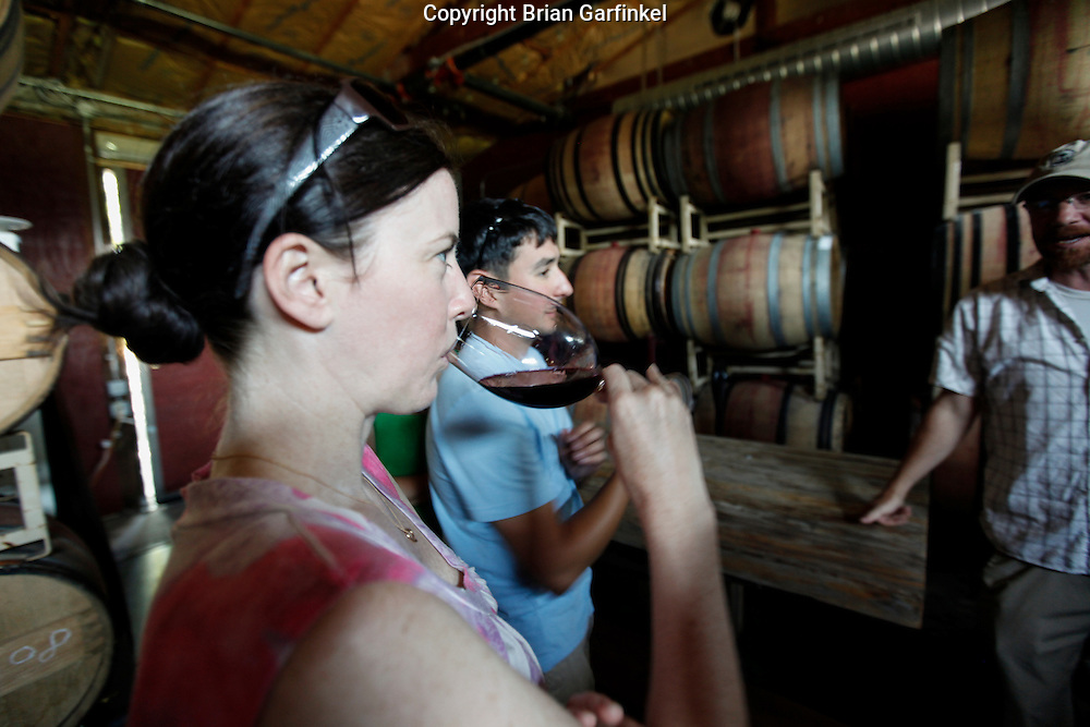 Allison tastes wine from the barrel at Lava Vine Winery tasting room on Sunday July 15th 2012 in Calistoga, California. (Photo By Brian Garfinkel)