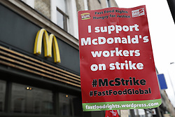 © Licensed to London News Pictures. 04/09/2017. London, UK. Striking McDonald's workers and their supporters hold a rally outside the King's Cross branch of the fast food restaurant. Workers at two restaurants in Cambridge and London have voted to take industrial action in the first ever strike at the fast-food chain in the UK. Employees are seeking better working conditions and the end of zero-hour contracts. Photo credit: Peter Macdiarmid/LNP