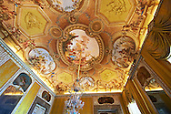 The Autumn Room- Frescoes on the vaulted ceiling depict the meetingbetween Bacchus and Ariadne, by Antonio de Dominici. Over the doors & mirrors are paintings by Gerolamo Starace painted between 1780-81, showing the mythical subjects of : Ceres, Allorgories of Dianna, Vulca, The Allagories of Saturn, Juno and Apollo. The Kings of Naples Royal Palace of Caserta, Italy. A UNESCO World Heritage Site