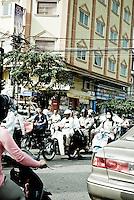 Rush  Hour Moped Traffic in Phnom Penh, Cambodia