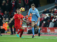 Liverpool's Dejan Lovren tussles with Stoke's Peter Crouch during the Premier League match at Anfield Stadium, Liverpool. Picture date December 27th, 2016 Pic David Klein/Sportimage