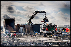October 27, 2016 - Calais, Northern France, France - Image ©Licensed to i-Images Picture Agency. 27/10/2016. Calais, France. Calais Jungle Migrant Camp. Bulldozer's dismantle the Calais Jungle migrant camp as Refugees leave  the Calais Jungle migrant camp the day after it caught fire and the French police closed it down. Picture by Andrew Parsons / i-Images (Credit Image: © Andrew Parsons/i-Images via ZUMA Wire)