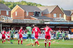 © Licensed to London News Pictures . 18/05/2016 . Accrington , UK . Four lads watch the match from a roof overlooking the pitch  . Accrington Stanley take on AFC Wimbledon at the Wham Stadium , in the 2nd leg of their League Two tie , the result from which will decide which team goes on to the final at Wembley . Photo credit : Joel Goodman/LNP