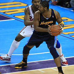 28 January 2009:  Denver Nuggets center Nene Hilario (31) is defended by New Orleans Hornets center Hilton Armstrong (12) during a 94-81 win by the New Orleans Hornets over the Denver Nuggets at the New Orleans Arena in New Orleans, LA. The Hornets wore special throwback uniforms of the former ABA franchise the New Orleans Buccaneers for the game as they honored the Bucs franchise as a part of the NBA's Hardwood Classics series. .