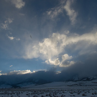 Clouds from a clearing winter storm swirl over the Mono Craters, a group of relatively young volcanoes east of the Sierra Nevada crest in California.