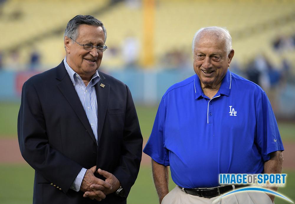 Sep 6, 2016; Los Angeles, CA, USA; Los Angeles Dodgers spanish language broadcaster Jaime Jarrin (left) and former manager Tommy Lasorda during a MLB game against the Arizona Diamondbacks at Dodger Stadium.