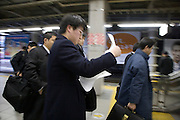 Japanese business people rushing while doing there paperwork