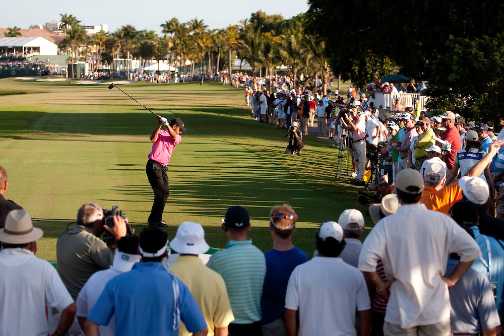 DORAL, FL - MARCH 15:  Jeev Milkha Singh hits his shot in front of the gallery during the fourth round of the 2009 WGC-CA Championship at Doral Golf Resort and Spa in Doral, Florida on Sunday, March 15, 2009. (Photograph by Darren Carroll) *** Local Caption *** Jeev Milkha Singh