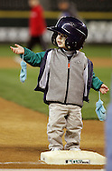 Two year old Quinn Elliott reaches up for assistance from his mother Fredrica to step up on third base while rounding the bases during the Seattle Mariners FanFest  in Seattle. (AP Photo/John Froschauer)