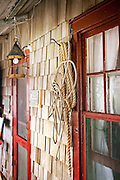 Rope is hung on the front porch of a coastal cottage
