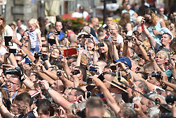 Crowds greet the Duke and Duchess of Cambridge (not pictured) as they visit the Dlugi Targ market in Gdansk on the second day of their three-day tour of Poland.