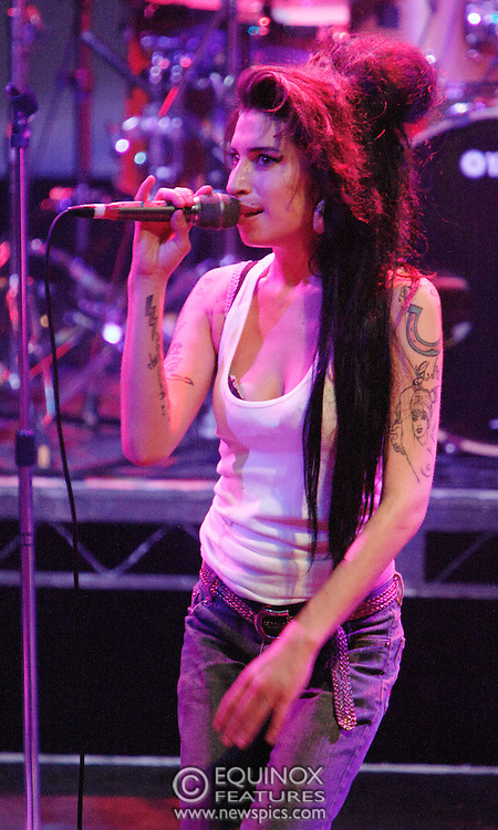 Singer Amy Winehouse, DOB=14/09/1983, performing for her gay fans at the G-A-Y Club. G-A-Y is London's biggest gay club and is held at the London Astoria nightclub, Soho, London, UK. Amy spent much of the show rubbing her itchy nose. She also seemed to have signs of old scars all down one arm...Picture Data:.Photographer: Edward Hirst.Copyright: ©2007 Licensed to Equinox News Pictures +448700 780000.Contact: Equinox Features.Date Taken: 20070415.Time Taken: 020248+0000.www.newspics.com