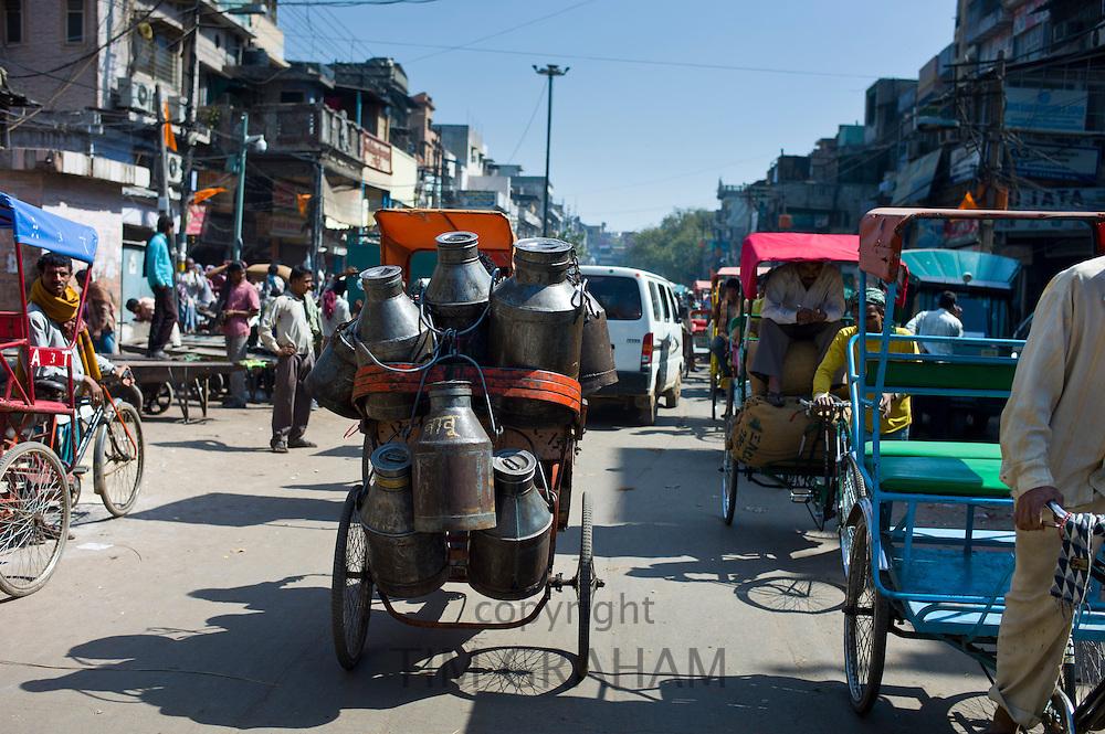 Milk churns on rickshaw at Khari Baoli food market, Old Delhi, India