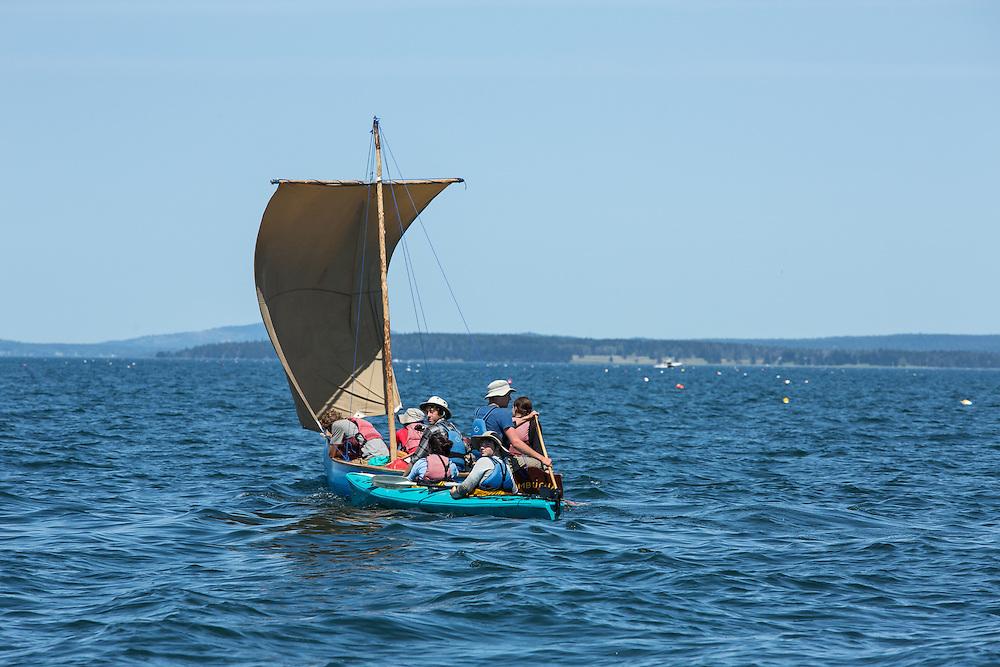 Penobscot Bay, ME - 12 August 2014. Square-sterned sailing canoe Kombucha, with a kayak alongide,  sailing up the bay.