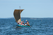 Penobscot Bay, ME - 12 August 2014. Square-sterned sailing canoe Kombucha, with a kayak alongide,  sailing up the bay.