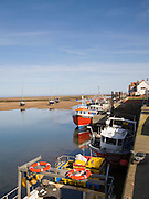 Fishing boats at low tide at Wells next the Sea, Norfolk, England