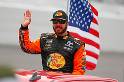 February 10, 2019 - Daytona, FL, U.S. - DAYTONA, FL - FEBRUARY 10: Martin Truex Jr., driver of the #19 Bass Pro Shops/Tracker ATVs Toyota, waves during the Advance Auto Parts Clash on February 10, 2019 at Daytona International Speedway in Daytona Beach, FL. (Photo by David Rosenblum/Icon Sportswire) (Credit Image: © David Rosenblum/Icon SMI via ZUMA Press)
