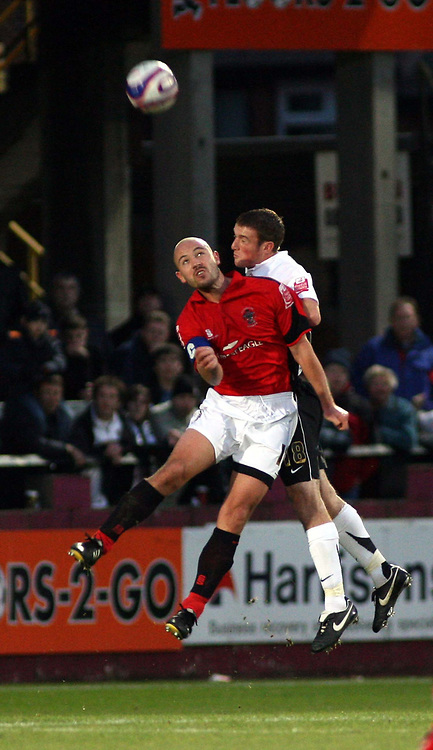 Photo: Mark Stephenson/Sportsbeat Images.<br /> Hereford United v Accrington Stanley. Coca Cola League 2. 24/11/2007.Accrington's  Paul Mullin wins the ball from Hereford's Lee Collins
