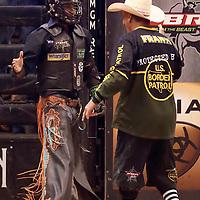 LAS VEGAS, NV - JUNE 11: Cody Jesus celebrates following his ride of bull Strange Cargo during the PBR Las Vegas Invitational, on June 11, 2021, at the MGM Grand Garden Arena, in Las Vegas, Nevada. (Photo by Chris Elise)