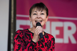 London, UK. 19 October, 2019. Caroline Lucas, Green MP for Brighton Pavilion, addresses hundreds of thousands of pro-EU citizens at a Together for the Final Say People's Vote rally in Parliament Square as MPs meet in a 'super Saturday' Commons session, the first such sitting since the Falklands conflict, to vote, subject to the Sir Oliver Letwin amendment, on the Brexit deal negotiated by Prime Minister Boris Johnson with the European Union.