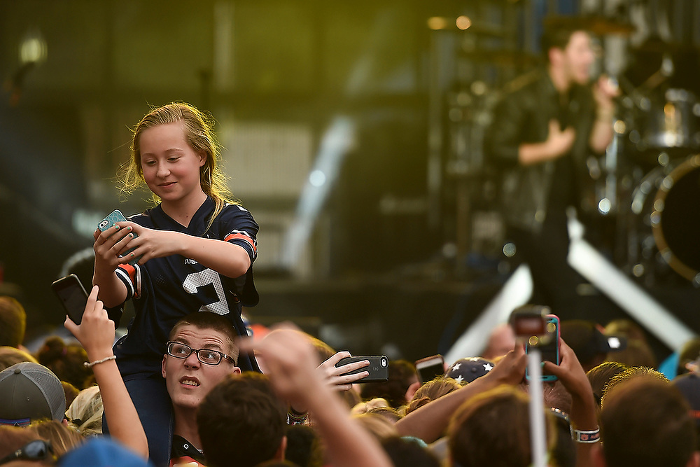 A fan takes a selfie during a performance by Nick Jonas at Toomer's Corner. <br /> Auburn Airwaves at Toomer's Corner in Auburn, Ala. on Saturday, April 18, 2015. <br /> Zach Bland