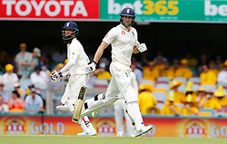 England's Moeen Ali and Dawid Malan run between the wickets during day two of the Ashes Test match at The Gabba, Brisbane.