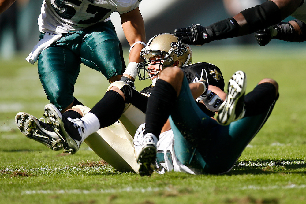 New Orleans Saints quarterback Drew Brees #9 is sacked during the NFL game between the New Orleans Saints and the Philadelphia Eagles on September 20th 2009. The Saints won 48-22 at Lincoln Financial Field in Philadelphia, Pennsylvania. (Photo By Brian Garfinkel)