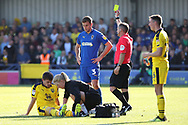 AFC Wimbledon defender Ben Purrington (3) yellow card during the EFL Sky Bet League 1 match between AFC Wimbledon and Oxford United at the Cherry Red Records Stadium, Kingston, England on 29 September 2018.