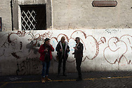 Three women share a smoke and a glass of wine during a lunch break, Rome, Italy