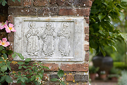 A plaque on a wall by the Bishop's Gate entrance to the White Garden at Sissinghurst Castle