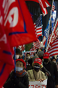 """A Japanese woman, wearing  a Make America Great Again baseball cap is one of several hundred people, taking part in a """"March For Trump"""" rally  in support of the out-going United States President, Donald Trump. Tokyo, Japan. Wednesday January 6th 2021. The rally of mostly Japanese people took place as part of a similar rally by Trump-supporters in Washington DC as the results of the 2020 US Presidential election were confirmed."""