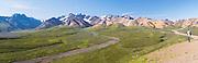 A female tourist enjoys her view of Polychrome Basin, Denali National Park, Alaska.