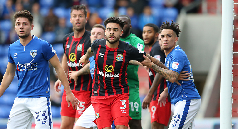 Blackburn Rovers' Derrick Williams watched by Oldham Athletic's Kean Bryan and Peter Clarke as they wait for a corner kick<br /> <br /> Photographer Stephen White/CameraSport<br /> <br /> The EFL Sky Bet League One - Oldham Athletic v Blackburn Rovers - Saturday 14th October 2017 - Boundary Park - Oldham<br /> <br /> World Copyright © 2017 CameraSport. All rights reserved. 43 Linden Ave. Countesthorpe. Leicester. England. LE8 5PG - Tel: +44 (0) 116 277 4147 - admin@camerasport.com - www.camerasport.com
