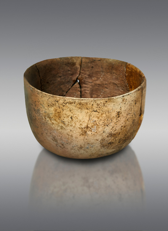 Neolithic terracotta bowl. Catalhoyuk collection, Konya Archaeological Museum, Turkey. Against a gray background .<br /> <br /> (updated 2021) Add photos of Catalhoyuk Antiquities using ADD TO CART button as royalty free download or prints or download from our ALAMY STOCK LIBRARY page at https://www.alamy.com/portfolio/paul-williams-funkystock - Scroll down and type -  Catalhoyuk  - into LOWER search box. (TIP - Refine search by adding a background colour as well).<br /> <br /> Visit our PREHISTORIC PLACES PHOTO COLLECTIONS for more  photos to download or buy as prints https://funkystock.photoshelter.com/gallery-collection/Prehistoric-Neolithic-Sites-Art-Artefacts-Pictures-Photos/C0000tfxw63zrUT4