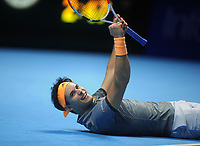 Tennis - 2019 Nitto ATP Finals at The O2 - Day Three<br /> <br /> Singles Group Bjorn Borg: Novak Djokovic (Serbia) vs.Domininic Thiem (Austria)<br /> <br /> Domininic Thiem drops to the floor in delight after winning the match in 3 sets<br /> <br /> COLORSPORT/ANDREW COWIE
