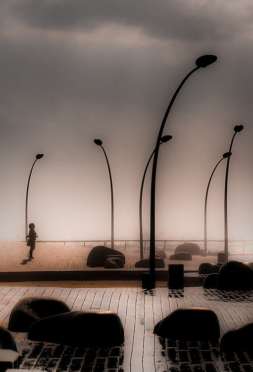 Stone sculptures and lamp posts Tel-Aviv beach promenade