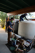 WMG staffers Charlie Alcorn and Nichole Casebeer return to give my cistern a final coat of paint.