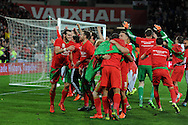Gareth Bale of Wales (l) leads the celebrations after the match as the Wales team qualify for Euro 2016 finals in France.  Wales v Andorra, Euro 2016 qualifying match at the Cardiff city stadium  in Cardiff, South Wales  on Tuesday 13th October 2015. <br /> pic by  Andrew Orchard