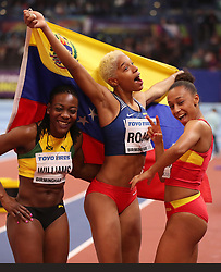 Venezuela's Yulimar Rojas (centre) celebrates winning the Women's Triple Jump with Spain's Ana Peleteiro (right) and Jamaica's Kimberly Williams (left), during day three of the 2018 IAAF Indoor World Championships at The Arena Birmingham.