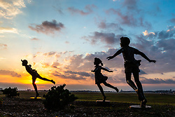 Share the Dream sculptures of running children at play, Founders Plaza, DFW Airport, Texas, USA.