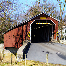 Leola, PA / USA – February 3, 2020: Pinetown Bridge is a red, 133 feet long covered bridge that spans the Conestoga River in Lancaster County.