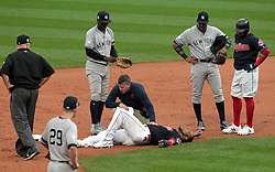 October 6, 2017 - Cleveland, OH, USA - The Cleveland Indians' Edwin Encarnacion grimaces in pain after being injured as he attempted to avoid a double play at second base on a line drive by Jay Bruce in the second inning against the New York Yankees during Game 2 of the American League Division Series, Friday, Oct. 6, 2017, at Progressive Field in Cleveland. (Credit Image: © Mike Cardew/TNS via ZUMA Wire)