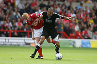 Photo: Pete Lorence.<br />Nottingham Forest v Swansea City. Coca Cola League 1. 30/09/2006.<br />Darren Pratley fends off Gary Holt.