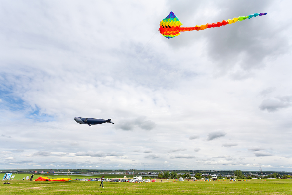 Kites soar above the crowds. Windscape Kite Festival, Swift Current, Saskatchewan.