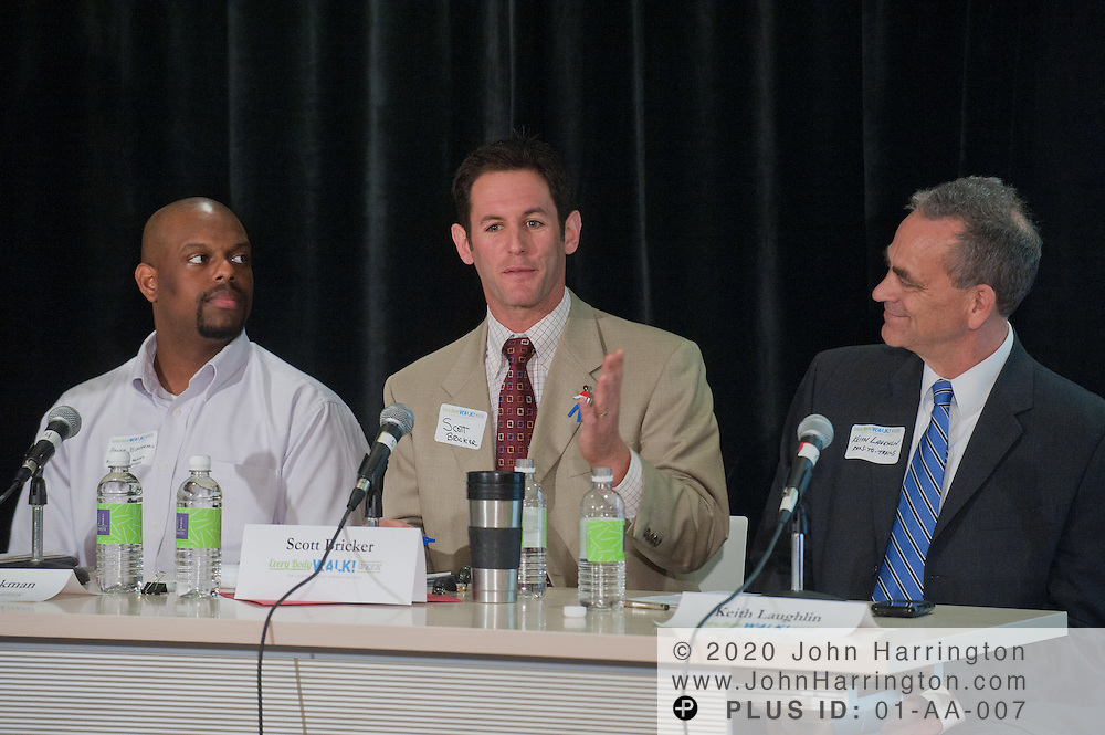 Scott Bricker (C), Executive Director, America Walks speaks during a panel discussion at the Walking Summit as Keith Laughlin (R), President of Rails-to-Trails Conservancy and Andre Blackman (L), Director, Digital Communications, American Heart Association looks on at the Center for Total Health in Washington, DC on September 20th, 2011. Kaiser Permanente advocated their Every Body Walk Campaign by bringing leaders and health experts to discuss the healthy benefits of incorporating walking into a daily routine.